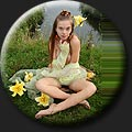 A cute teen model Milena Diaz (21) posing with yellow flowers outdoor.