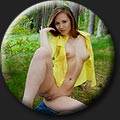 Amateur model Mira Davis (21) takes off her yellow shirt and blue denim shorts outdoor.