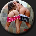 Two pretty women Sofi (26) and Vika (30) in very short polka dots skirts teasing outdoor.
